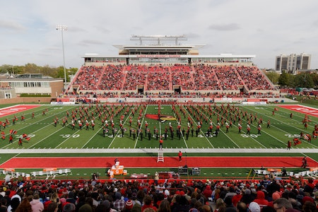 Illinois State University's marching band on the football field at homecoming.
